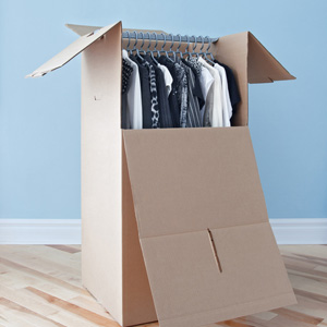 Wardrobe box with black and white clothing, prepared for transportation.